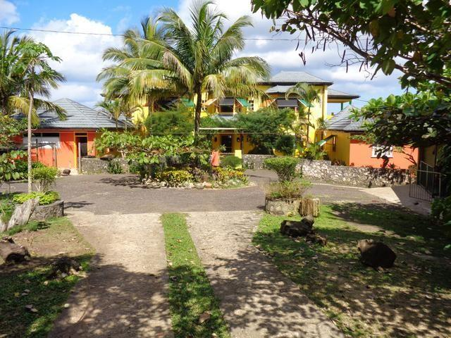 Tropical estate consist of a 2 story home with 6 bedrooms, 5 bathrooms, a guest cottage with 6 bedrooms, 6 bathrooms and an additional one bedroom apartment presently used for accommodation