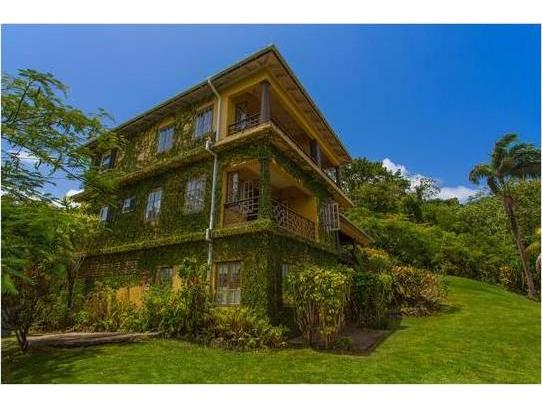 Nestled in the cool San San hills, Melarky is a four bedroom house filled with country charm set over three ivy-covered floors featuring classic Jamaican features and stunning views overlooking San San Bay