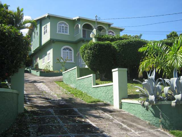This two family house (set up as a townhouse) is is located in a prestigious section of Spring Valley, St Mary with an excellent view of the the Caribbean Sea