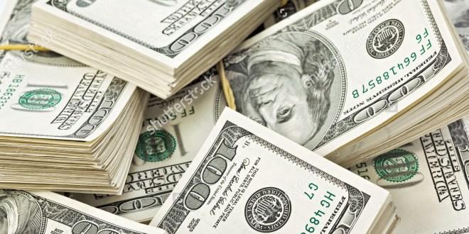 many-bundle-of-us-dollars-bank-notes-55204831
