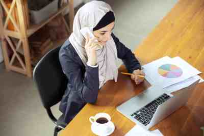 Portrait of a beautiful arabian businesswoman wearing hijab while working