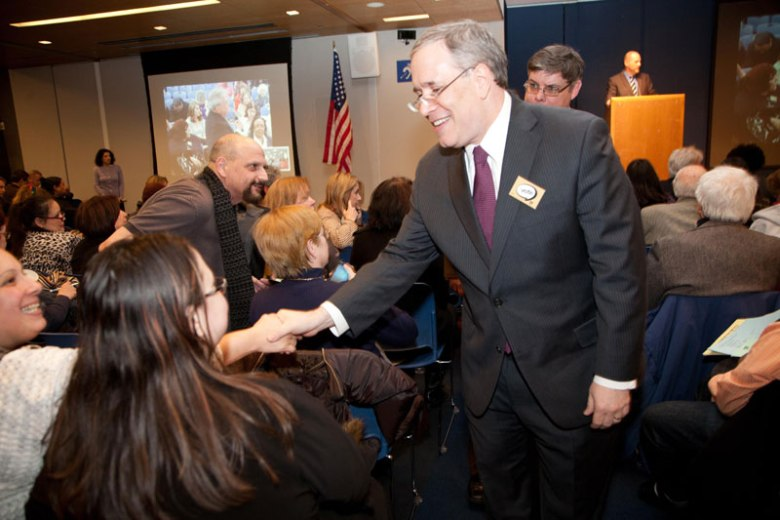 Manhattan Borough President Scott Stringer greets delegates after they approved a resolution to endorse him in his run for city comptroller