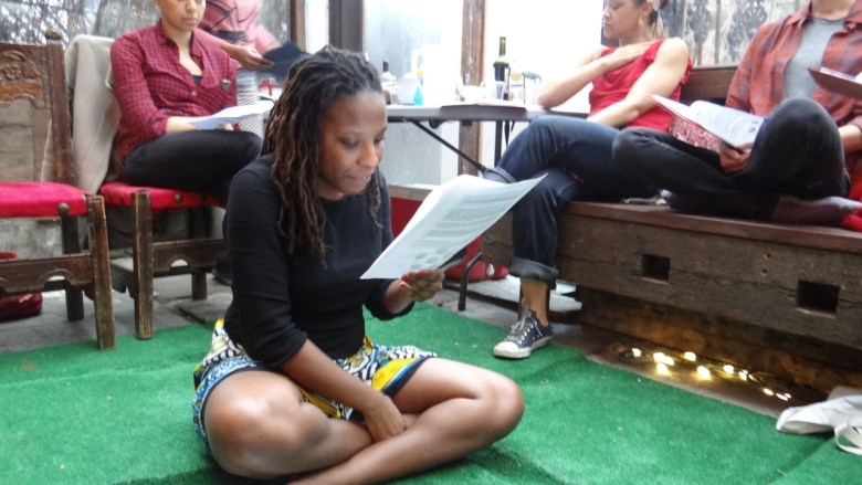 """Brittanie Richardson sits with the """"Art and Abolition"""" family in Brooklyn, organizing roles and a fundraising initiative before her trip back to Kenya."""