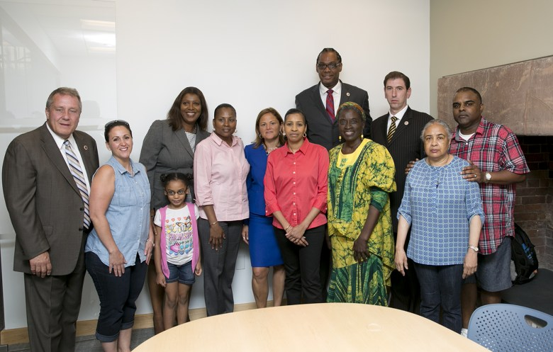 """Councilmember Robert Cornegy with Avonte Oquendo's family shortly after """"Avonte's Law"""" passed in the City Council"""