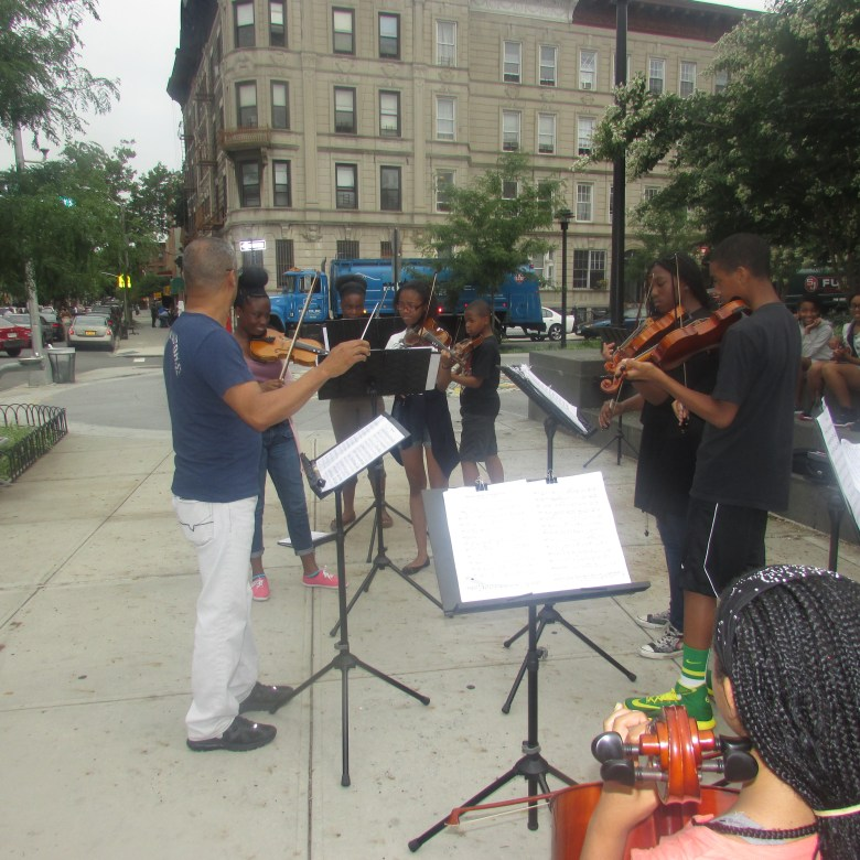 Noel Pointer Foundation Youth String members play at the Marcy Plaza Farmers Market Opening Day, July 16, 2014