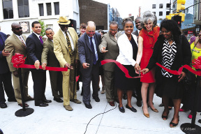 At the ribbon-cutting for the  new Marcy Plaza Shown (l to r): Colvin Grannum, Kyle Kimball, Al Vann, David Jones, Wayne Winborne, Tremaine Wright, Kate Levin and Joyce Turner