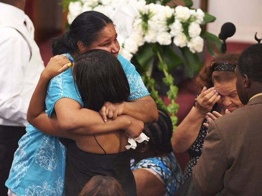 Family of Eric Garner mourns at his funeral Photo: USAToday