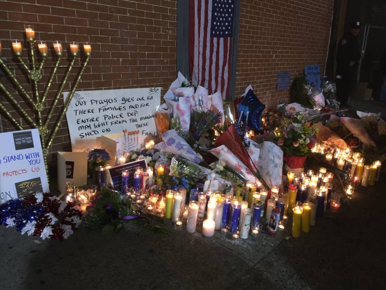 Shrine grows to honor slain NYPD officers