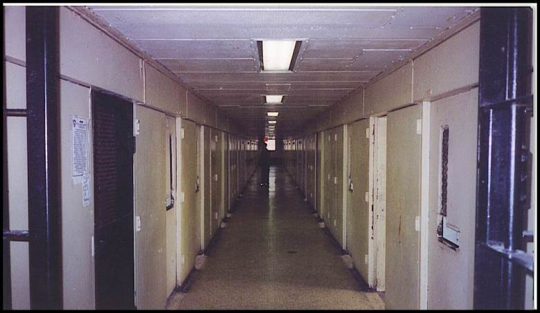 """If you look down the corridor of this adolescent """"bing"""" you see a lone body. This is the suicide aide the most valuable person in solitary confinement.  Photo: Lorenzo Steele Jr."""