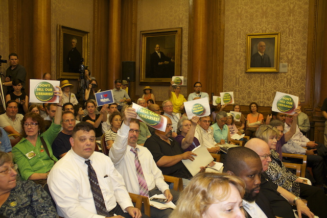 Hearing on Proposed Library Sale Draws Differing Views