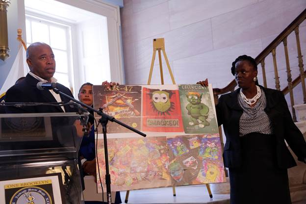 Brooklyn Borough President Eric L. Adams and Della Ellis, a resident of Downtown Brooklyn recovering from an addiction to K2, hold up a poster displaying examples of colorful packaging used to wrap the drug at a press conference in Brooklyn Borough Hall, where he issued a call to action to address synthetic marijuana's impact on public health and safety.   Photo: Ron Ricardo/Brooklyn BP's Office