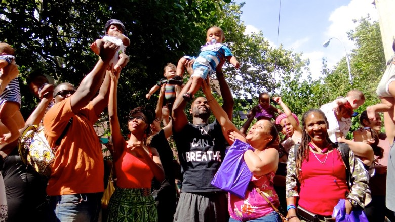 """Mothers (and some fathers) participate in the first-ever national """"Lift Every Baby"""" event in Bed-Stuy"""