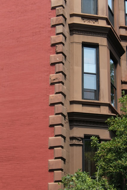 The brown colored sandstone on 'brownstones' in Park Slope, Brooklyn, is only a faccade, the walls beneath are red brick. Photographer, Sotero Bernal