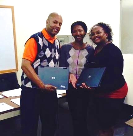 (l to r) Keith H. Burgess, CEO/executive director of the Dollicia F. Holloway Memorial Foundation, Inc.; La'Shawn Allen-Muhammad, executive director of The Central Brooklyn Economic Development Corporation; and Altanya Gerald-Burgess, COO/deputy executive director of The Dollicia F. Holloway Memorial Foundation, Inc.