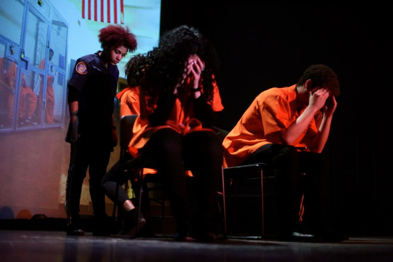 Truthworker Theatre Company performing Bar Code: A performative analysis of the school to prison pipeline. Columbia University School of Public Health, April 2014. From left: James Gagliardo, Oddisey Miller. Back: Leah Mohammed. Photo credit: Liaizon Wakest