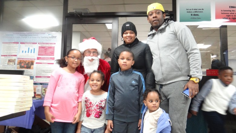 A family poses with Santa at the Brookdale Hospital Christmas Party