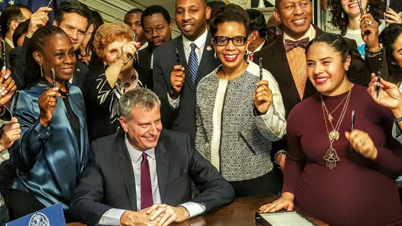 Mayor Bill de Blasio, First Lady Chirlane McCray, joined by Council Member Laurie A. Cumbo and other elected officials on stand with the mayor as he signed into law the Paid Paternal Leave Personnel Order for New York City workers