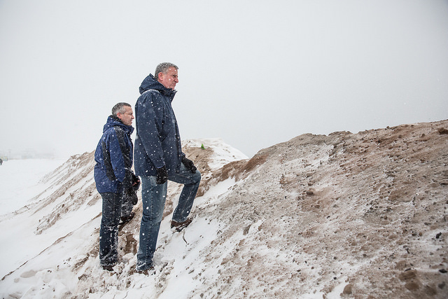 New York City Mayor Bill de Blasio stands with the Director of The Mayor's Office of Recovery and Resiliency, Daniel Zarrilli on a temporary sand berm which was built to protect against storm surge flooding on the beach at Coney Island during a major snowstorm on Saturday, January 23, 2016. Michael Appleton/Mayoral Photography Office