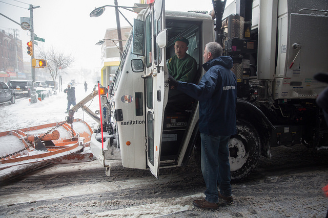 New York City Mayor Bill de Blasio thanks a sanitation worker plowing the streets as he inspects the conditions at Coney Island during a major snowstorm on Saturday, January 23, 2016. Michael Appleton/Mayoral Photography Office