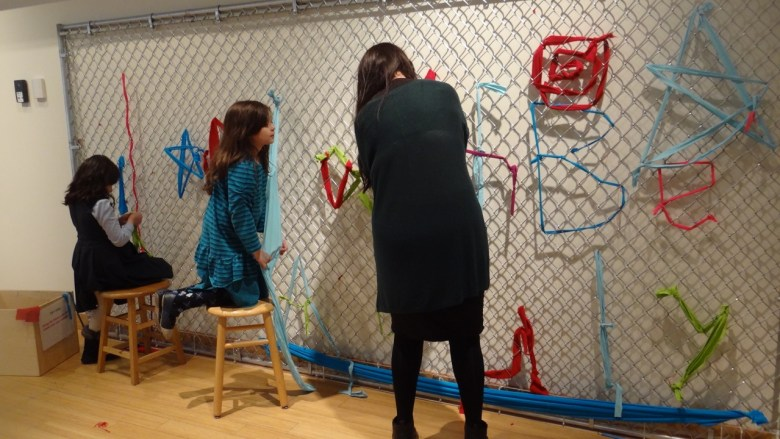 Oasa Duverney and Mildred Beltre of Brooklyn Hi-Art Machine's iconic fence weaving project offers visitors an opportunity to author and illustrate a message that they want to share with their neighbors.