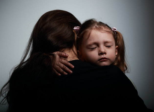 Sad crying daughter hugging her mother