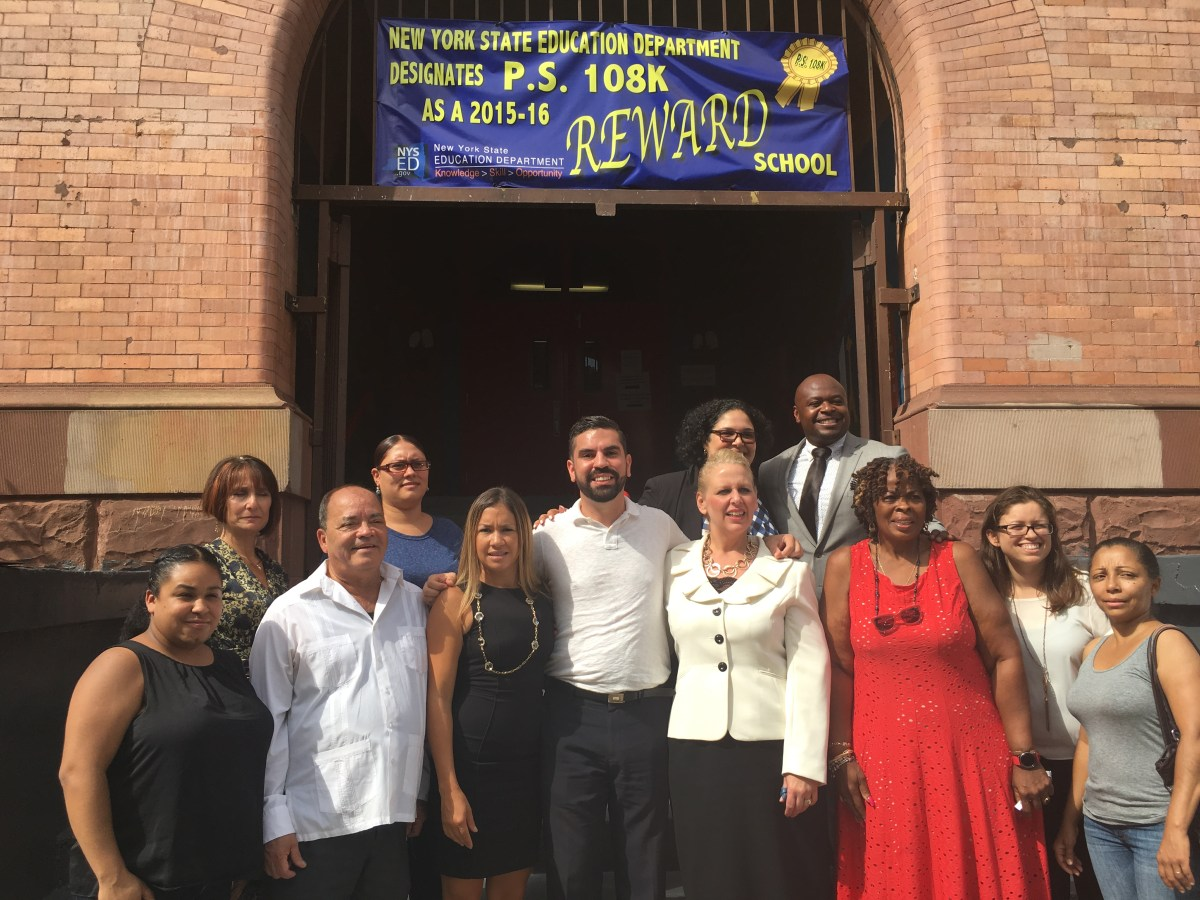 City Councilmember Rafael Espinal (center) stands with NYC Schools Chancellor Carmen Farina, State Sen. Martin Malavé Dilan and school administrators at press conference announcing $17.45 million Espinal secured for schools in his district.