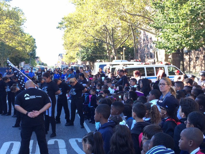 Students from P.S. 59 watch the Ramos Foundation's student drill team perform.