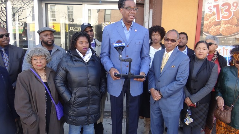 City Councilmember Robert Cornegy holds press conference on deed fraud. To his left L. Joy Williams, president of the NAACP, Brooklyn Chapter; the right, Richard Flateau, owner of Flateau Realty Corp