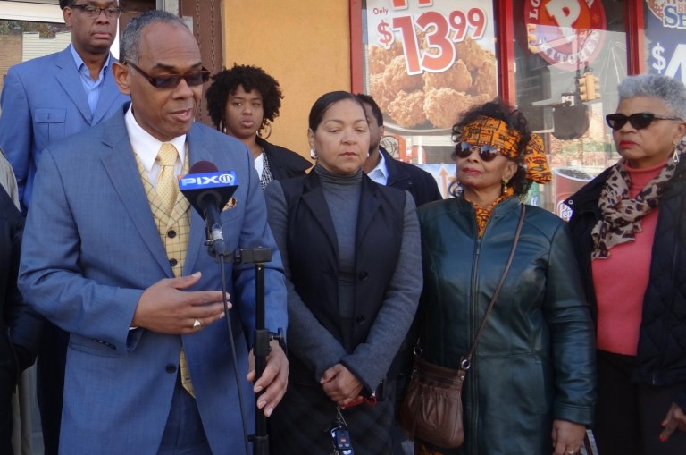 (far left) Richard Flateau and his partner Gloria Sandiford (to his left) speak at a press conference concerning a property the two owned that was almost taken as a result of deed fraud.