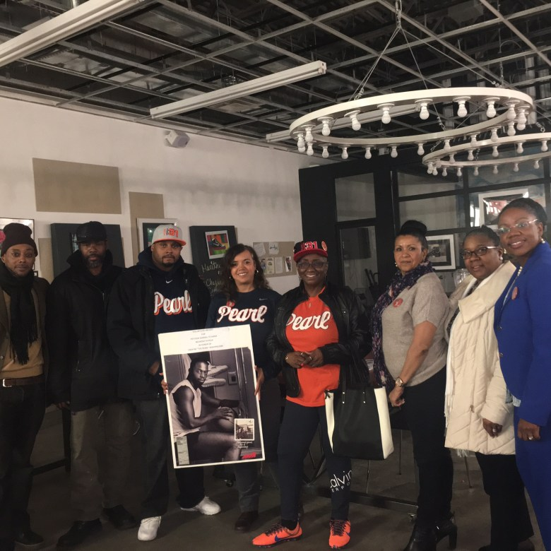 """Janie Washington-Bennett (4th from right) with volunteers who are campaigning for signatures to turn Belmont Avenue in Brownsville to """"Dwayne Pearl Washington Way."""""""