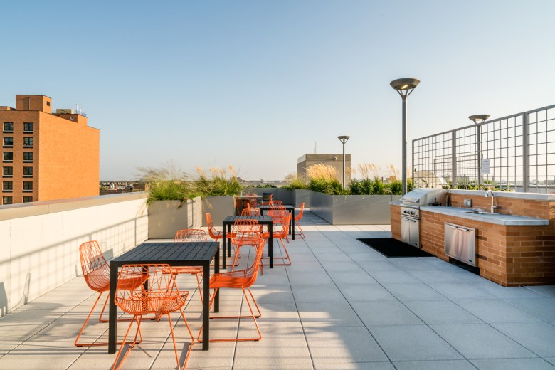The rooftops features bbq grills, hammocks and planters.