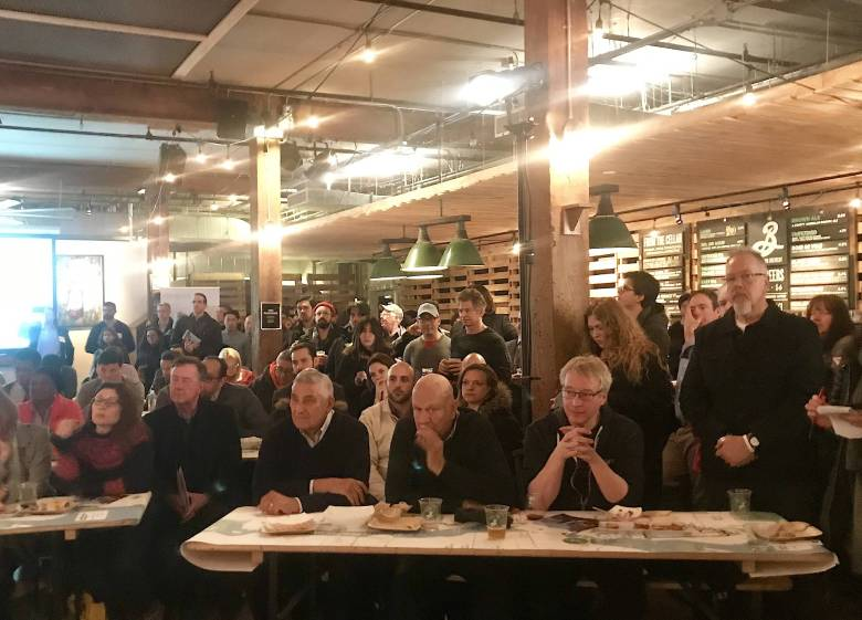 Brooklyn Brewer was packed with local residents and business owners who were interested in learning more about the impacts of streetcars on local communities.