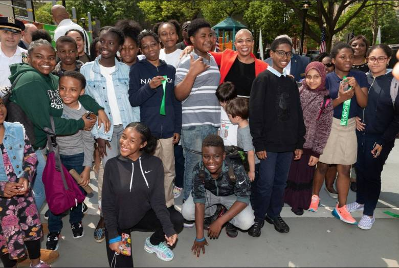Councilmember Laurie Cumbo (center-left) at Friday's reopening of the Elijah G. Stroud playground.