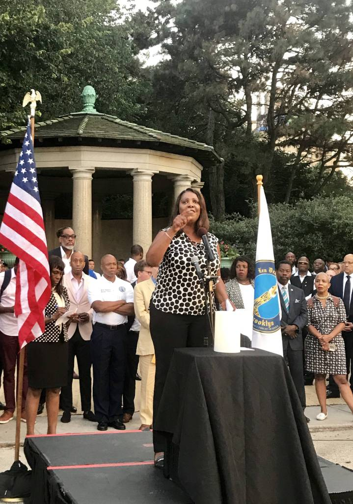 An emotional group of New York lawmakers and activists gathered at Grand Army Plaza Monday night to mourn the victims of the mass shootings