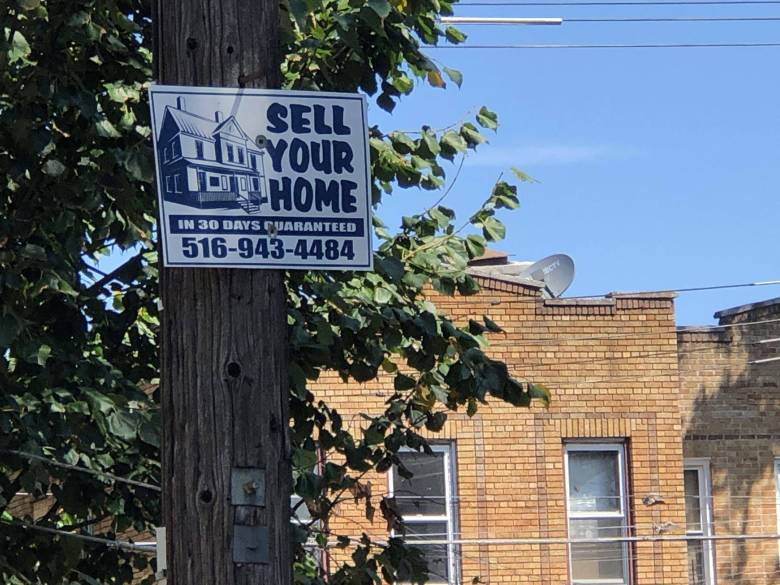Sell your house sign in East New York