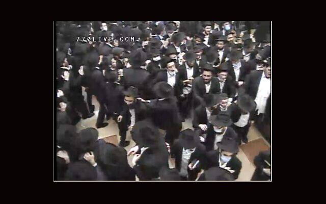 Amid increasing COVID alarm, packed services at Chabad's Brooklyn headquarters