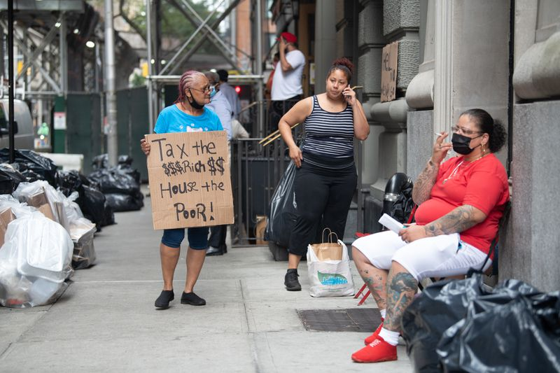 NYC shelter residents say city officials contacted them Wednesday, a week after trying to relocate them, to warn a future move could happen