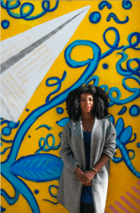 """One of Dawson's paper planes has a passage of the bible on it. """"The mural is a prayer for our children,"""" Dawson said. Photo: Provided by Industry City."""