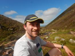 John at the halfway point beside the burn at the Lairig Ghru 'crossroads'.