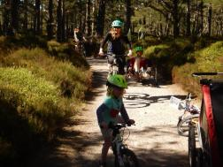 A family and friends cycle on the extensive path network around Glenmore.