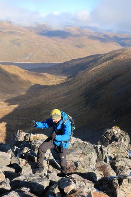 Peter Evans on the rocky ridge up Sron Garbh with Coire Domhain and Loch Mullardoch beyond.
