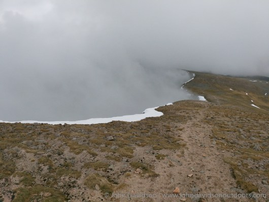 Looking back to the bealch below Sgor an Lochain Uaine as cloud drifts up from the Garbh Coire.