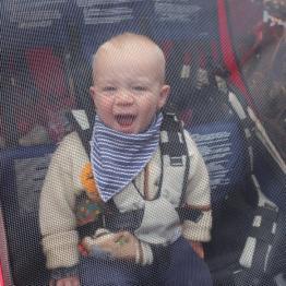 Matthew enjoys his ride in the trailer.
