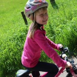 Jennifer is all smiles on her bike.