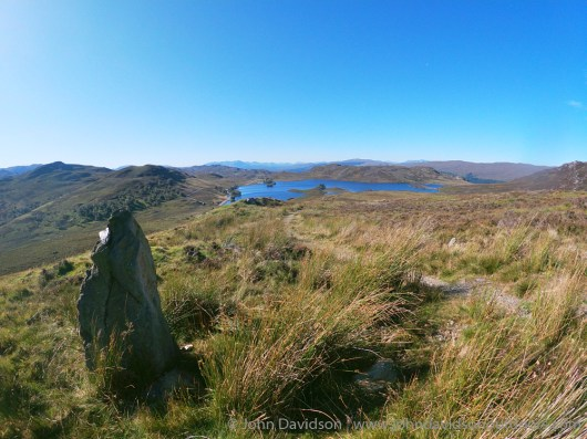 A standing stone on the way up to Carn an t-Suidhe, with Loch Tarff in the distance.