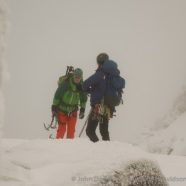 Two climbers emerge from the depths of the corrie having soloed an 'easy' route - despite carrying all their kit!
