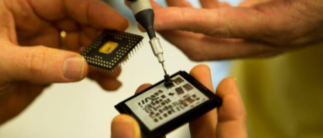 Hands holding electronic chips
