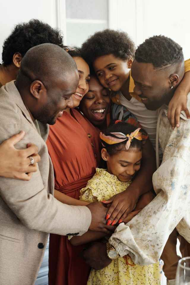 Black family hugging each other