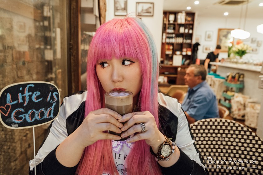 Pink hair Japanese style girl drinking hot chocolate in Melbourne cafe 2017