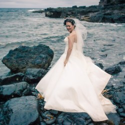 Melbourne wedding hair and makeup shot on pebble beach in Australia with white veil
